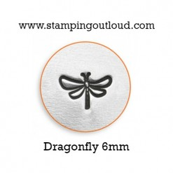 Dragonfly Metal Design Stamped on a Metal Blank.